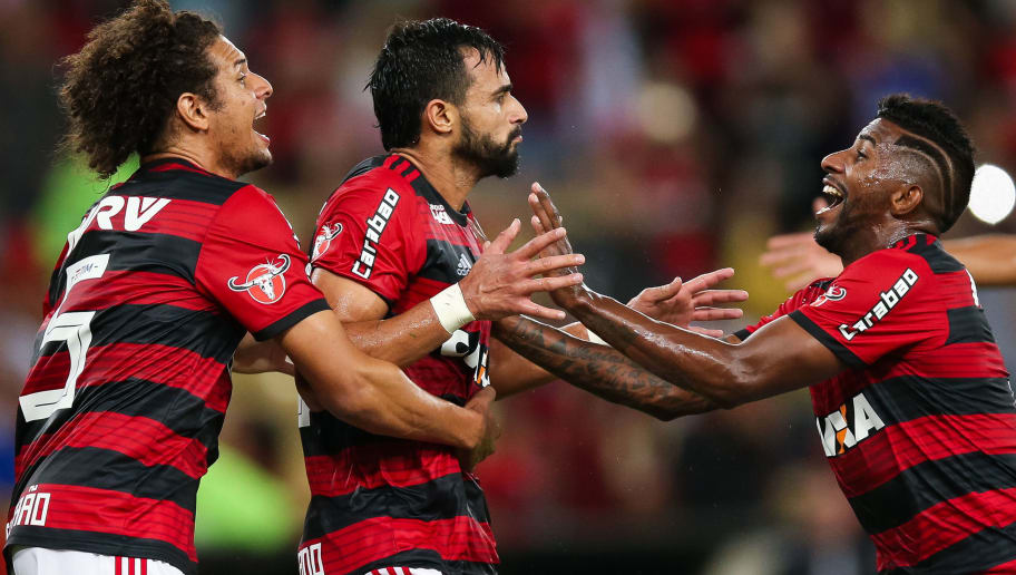 RIO DE JANEIRO, BRAZIL - APRIL 21: Henrique Dourado (C) of Flamengo celebrates a scored goal against America MG during a match between Flamengo and America MG as part of Brasileirao Series A 2018 at Maracana Stadium on April 21, 2018 in Rio de Janeiro, Brazil. (Photo by Buda Mendes/Getty Images)