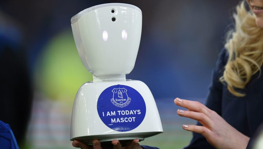 A member of staff holds an AV1 telepresence robot, allowing teenage fan Jack McLinden to be a 'virtual matchday mascot' ahead of the English Premier League football match between Everton and Newcastle United at Goodison Park in Liverpool, north west England on April 23, 2018. - A seriously ill teenage Everton fan made history on Monday becoming the world's first 'virtual matchday mascot' ahead of his beloved team's home Premier League match with Newcastle United. Jack McLinden, 14,  -- who suffers from multiple health conditions and is wheelchair bound -- was able to enjoy the once-in-a-lifetime mascot experience through the Norwegian-designed telepresence robot, AV1. (Photo by Oli SCARFF / AFP) / RESTRICTED TO EDITORIAL USE. No use with unauthorized audio, video, data, fixture lists, club/league logos or 'live' services. Online in-match use limited to 75 images, no video emulation. No use in betting, games or single club/league/player publications. /         (Photo credit should read OLI SCARFF/AFP/Getty Images)