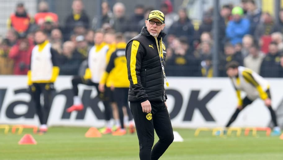 Dortmund's German headcoach Peter Stoeger (R) and co-trainer Manfred Schmid lead a training session of German first Bundesliga football team Dortmund, on which retired Jamaican Olympic and World champion sprinter Usain Bolt (unseen) took part on March 23, in Dortmund.   Bolt, 31, who holds the world records for the 100m and 200m, had already announced last January that he would be training with Dortmund during the current international break. / AFP PHOTO / Patrik STOLLARZ        (Photo credit should read PATRIK STOLLARZ/AFP/Getty Images)
