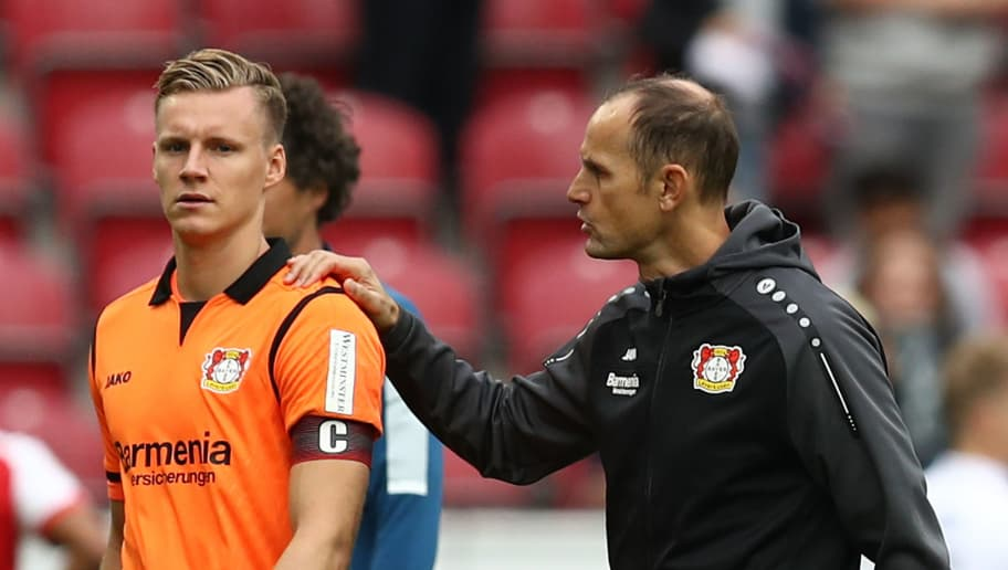 MAINZ, GERMANY - SEPTEMBER 09: Coach Heiko Herrlich of Bayer Leverkusen (r) attends to goalkeeper Bernd Leno of Bayer Leverkusen after the Bundesliga match between 1. FSV Mainz 05 and Bayer 04 Leverkusen at Opel Arena on September 9, 2017 in Mainz, Germany. (Photo by Maja Hitij/Bongarts/Getty Images)