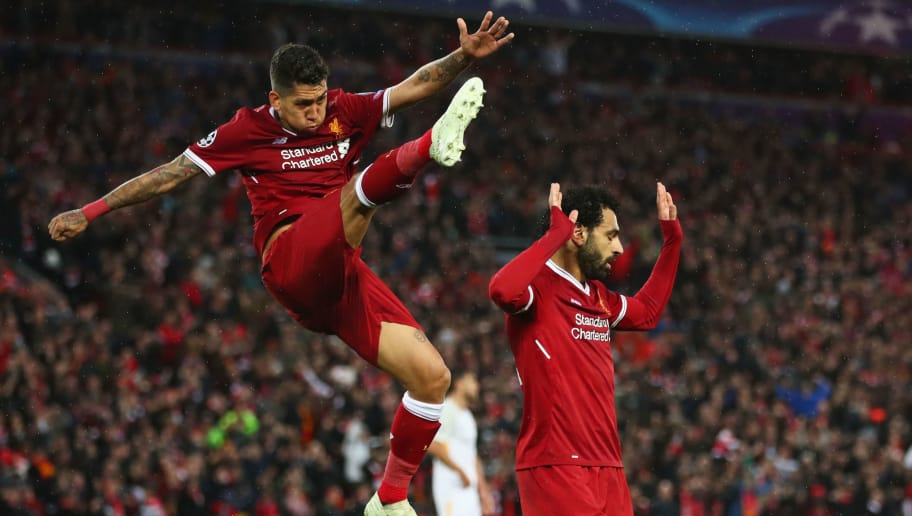 LIVERPOOL, ENGLAND - APRIL 24:  Mohamed Salah of Liverpool celebrates as he scores his sides second goal with Roberto Firmino during the UEFA Champions League Semi Final First Leg match between Liverpool and A.S. Roma at Anfield on April 24, 2018 in Liverpool, United Kingdom.  (Photo by Clive Brunskill/Getty Images)