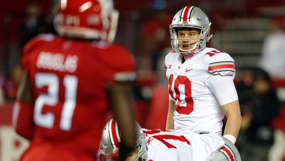 PISCATAWAY, NJ - SEPTEMBER 30: Quarterback Joe Burrow #10 of the Ohio State Buckeyes calls out signals during a game against the Rutgers Scarlet Knights on September 30, 2017 at High Point Solutions Stadium in Piscataway, New Jersey. Ohio State won 56-0. (Photo by Hunter Martin/Getty Images)