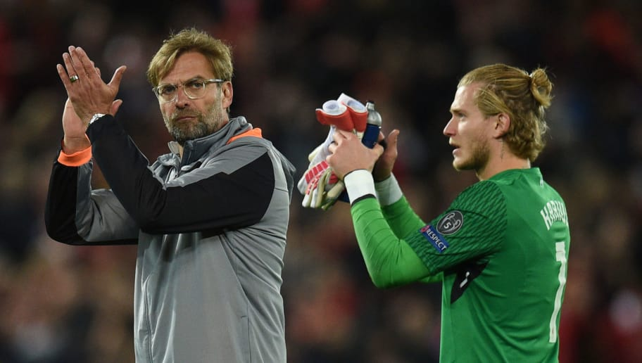 Liverpool's German manager Jurgen Klopp (L) and Liverpool's German goalkeeper Loris Karius applaud fans after the UEFA Champions League first leg semi-final football match between Liverpool and Roma at Anfield stadium in Liverpool, north west England on April 24, 2018. (Photo by Oli SCARFF / AFP)        (Photo credit should read OLI SCARFF/AFP/Getty Images)