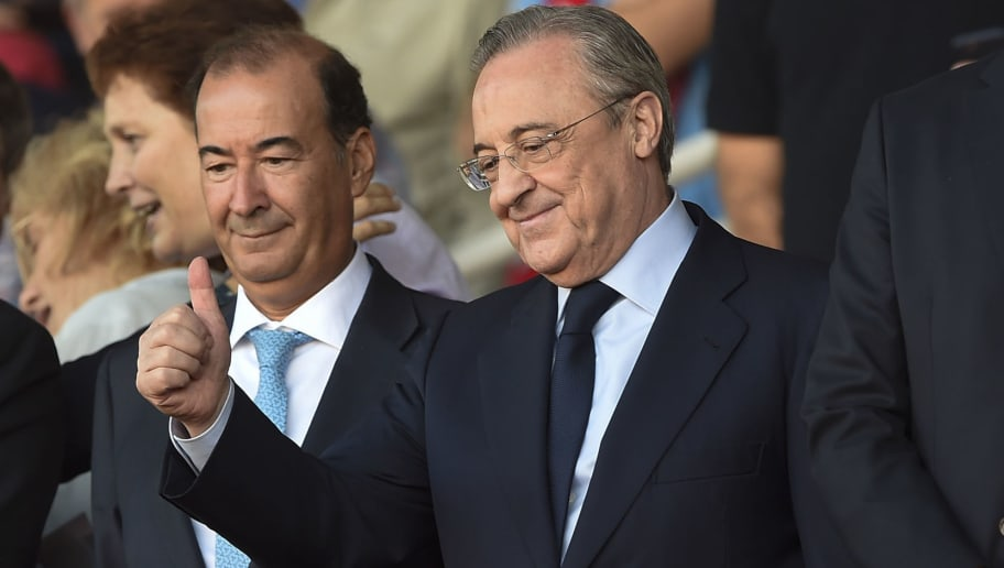 President of Real Madrid Florentino Perez (C) thumbs up from the stands during the Spanish league football match Girona FC vs Real Madrid CF at the Montilivi stadium in Girona on October 29, 2017. / AFP PHOTO / Josep LAGO        (Photo credit should read JOSEP LAGO/AFP/Getty Images)