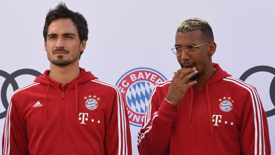 (L-R) Bayern Munich's Goalkeeper Sven Ulreich, Bayern Munich's defender Mats Hummels and Bayern Munich's defender Jerome Boateng are pictured during a car handover event at the Audi headquarters in Ingolstadt, southern Germany, on October 11, 2017.  / AFP PHOTO / Christof STACHE        (Photo credit should read CHRISTOF STACHE/AFP/Getty Images)