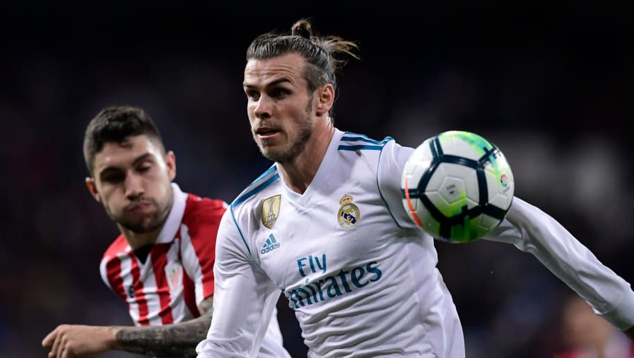 Real Madrid's Welsh forward Gareth Bale (R) vies with Athletic Bilbao's Spanish defender Unai Nunez during the Spanish league football match Real Madrid CF against Athletic Club Bilbao at the Santiago Bernabeu stadium in adrid on April 18, 2018. / AFP PHOTO / JAVIER SORIANO        (Photo credit should read JAVIER SORIANO/AFP/Getty Images)