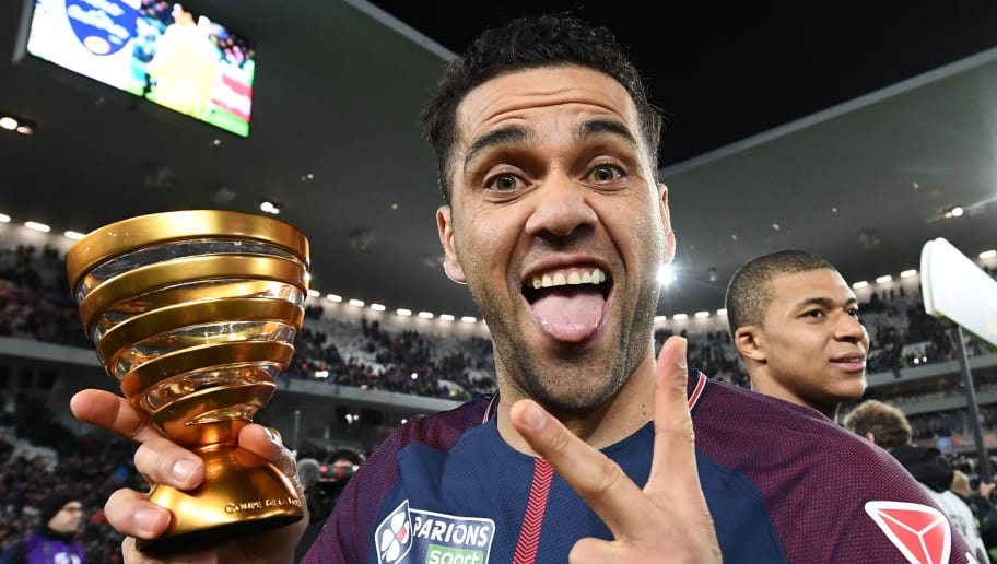 Paris Saint-Germain's Brazilian defender Daniel Alves holds the trophy as he celebrates after victory in the French League Cup final football match between Monaco (ASM) and Paris Saint-Germain (PSG) at The Matmut Atlantique Stadium in Bordeaux, southwestern France on March 31, 2018.  / AFP PHOTO / FRANCK FIFE        (Photo credit should read FRANCK FIFE/AFP/Getty Images)