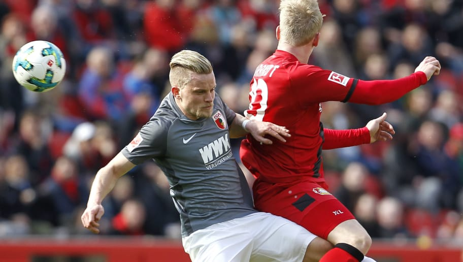 LEVERKUSEN, GERMANY - MARCH 31: Philipp Max of Augsburg (L) jumps for a header against Julian Brandt of Leverkusen during the Bundesliga match between Bayer 04 Leverkusen and FC Augsburg at BayArena on March 31, 2018 in Leverkusen, Germany. (Photo by Mika Volkmann/Bongarts/Getty Images)