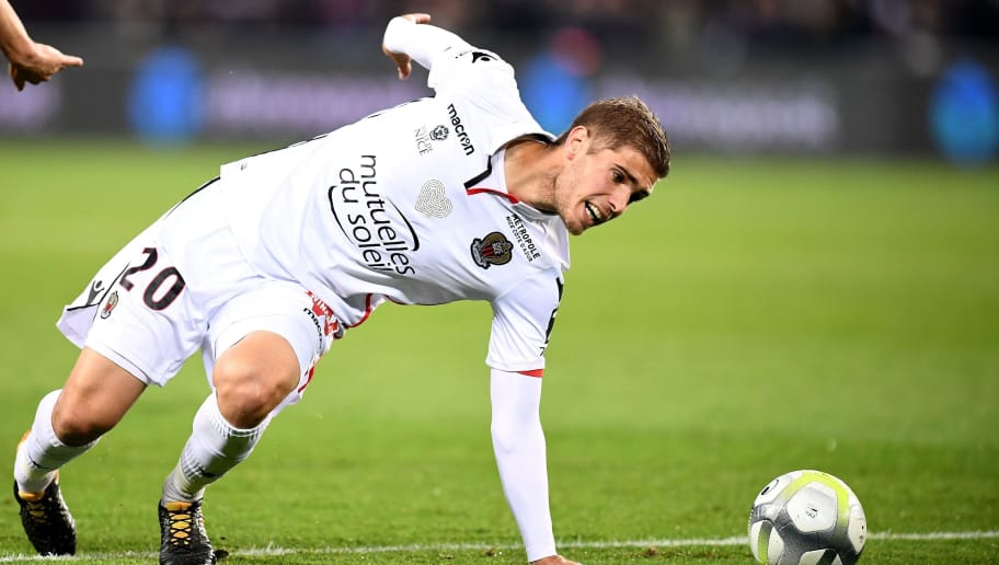 Nice's French defender Maxime Le Marchand falls during the French Ligue 1 football match between Paris Saint-Germain and Nice at the Parc des Princes stadium in Paris on October 27, 2017. / AFP PHOTO / FRANCK FIFE        (Photo credit should read FRANCK FIFE/AFP/Getty Images)