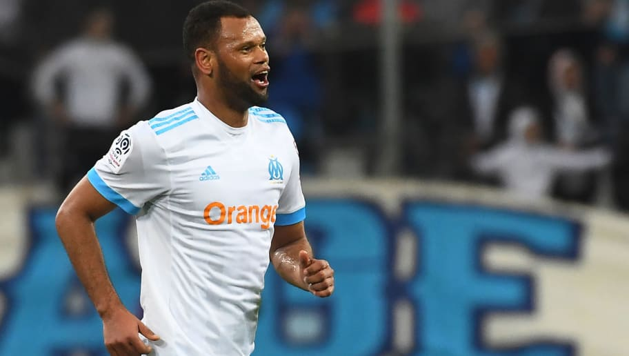 Olympique de Marseille's Portuguese defender Rolando celebrates after scoring a goal during the French L1 football match Marseille (OM) vs Lyon (OL) on March 18, 2018 at the Velodrome stadium in Marseille, southern France. / AFP PHOTO / ANNE-CHRISTINE POUJOULAT        (Photo credit should read ANNE-CHRISTINE POUJOULAT/AFP/Getty Images)