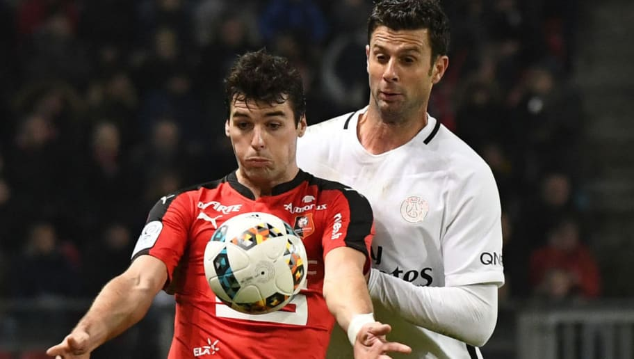 Rennes' French midfielder Yoann Gourcuff (front C) vies with Paris Saint-Germain's Italian midfielder Thiago Motta (rear C) during the French L1 football match between Rennes and Paris Saint-Germain on January 14, 2017 at the Roazhon park stadium in Rennes, western France. / AFP / DAMIEN MEYER        (Photo credit should read DAMIEN MEYER/AFP/Getty Images)