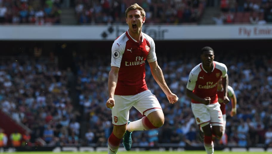 LONDON, ENGLAND - APRIL 22:  Nacho Monreal of Arsenal celebrates scoring his side's first goal during the Premier League match between Arsenal and West Ham United at Emirates Stadium on April 22, 2018 in London, England.  (Photo by Shaun Botterill/Getty Images)