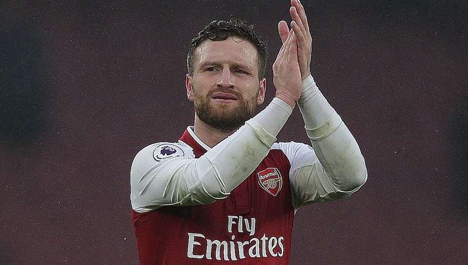 Arsenal's German defender Shkodran Mustafi applauds the fans following the English Premier League football match between Arsenal and Tottenham Hotspur at the Emirates Stadium in London on November 18, 2017.  / AFP PHOTO / Daniel LEAL-OLIVAS / RESTRICTED TO EDITORIAL USE. No use with unauthorized audio, video, data, fixture lists, club/league logos or 'live' services. Online in-match use limited to 75 images, no video emulation. No use in betting, games or single club/league/player publications.  /         (Photo credit should read DANIEL LEAL-OLIVAS/AFP/Getty Images)