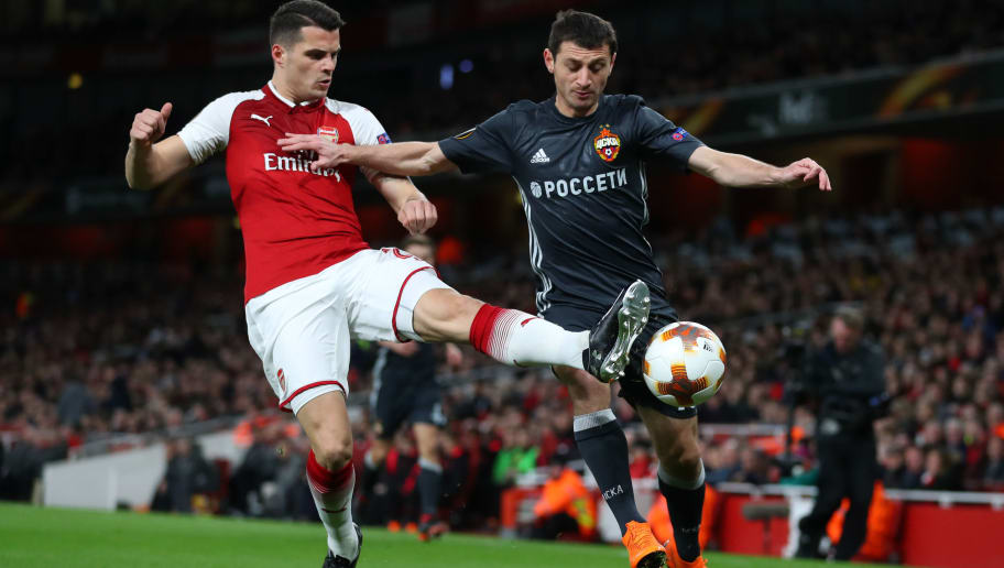 LONDON, ENGLAND - APRIL 05: Granit Xhaka of Arsenal battles for the ball with Alan Dzagoev of CSKA Moskva during the UEFA Europa League quarter final leg one match between Arsenal FC and CSKA Moskva at Emirates Stadium on April 5, 2018 in London, United Kingdom.  (Photo by Catherine Ivill/Getty Images)
