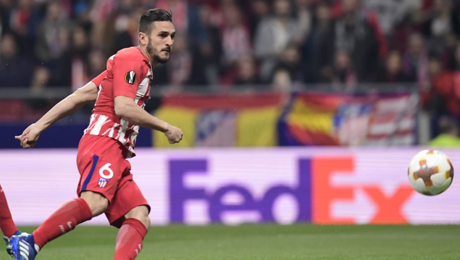 Atletico Madrid's Spanish midfielder Koke scores a goal during the UEFA Europa League quarter-final first leg football match between Atletico Club Atletico de Madrid and Sporting CP at the Wanda Metropolitano Stadium in Madrid on April 5, 2018. / AFP PHOTO / JAVIER SORIANO        (Photo credit should read JAVIER SORIANO/AFP/Getty Images)