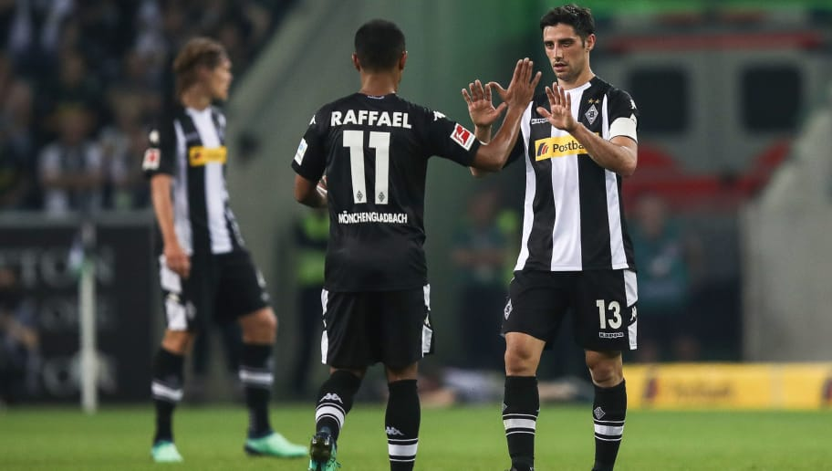 MOENCHENGLADBACH, GERMANY - APRIL 20: Raffael of Moenchengladbach and Lars Stindl celebrate after the Bundesliga match between Borussia Moenchengladbach and VfL Wolfsburg at Borussia-Park on April 20, 2018 in Moenchengladbach, Germany. (Photo by Maja Hitij/Bongarts/Getty Images)