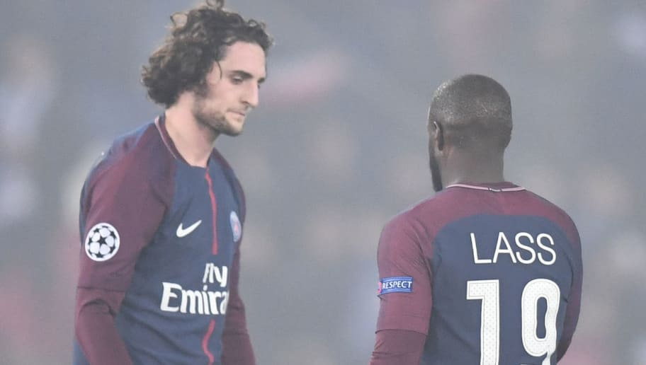 Paris Saint-Germain's French midfielder Adrien Rabiot (L) and Paris Saint-Germain's French midfielder Lassana Diarra  react after losing the UEFA Champions League round of 16 second leg football match between Paris Saint-Germain (PSG) and Real Madrid on March 6, 2018, at the Parc des Princes stadium in Paris. / AFP PHOTO / FRANCK FIFE        (Photo credit should read FRANCK FIFE/AFP/Getty Images)