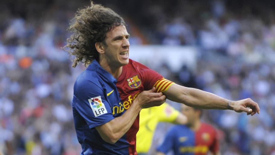 Barcelona's defender Carles Puyol celebrates after scoring his team's second goal during the Spanish League football match against Real Madrid at the Santiago Bernabeu stadium in Madrid  on May 2, 2009.   AFP PHOTO/PHILIPPE DESMAZES (Photo credit should read PHILIPPE DESMAZES/AFP/Getty Images)