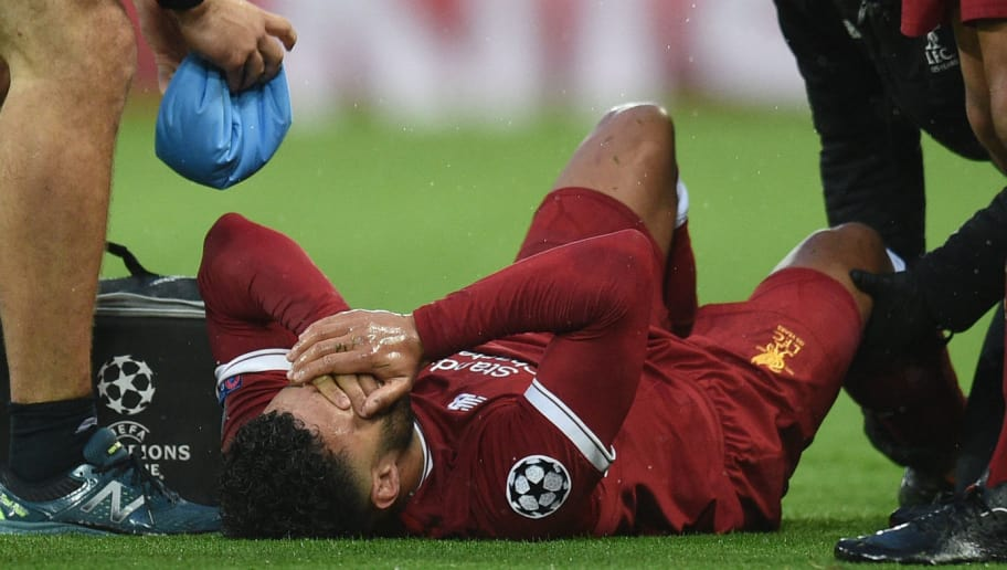 Liverpool's English midfielder Alex Oxlade-Chamberlain reacts after picking up an injury during the UEFA Champions League first leg semi-final football match between Liverpool and Roma at Anfield stadium in Liverpool, north west England on April 24, 2018. (Photo by Oli SCARFF / AFP)        (Photo credit should read OLI SCARFF/AFP/Getty Images)
