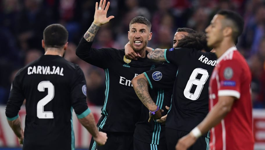 Real Madrid's Brazilian defender Marcelo (R) celebrates with Real Madrid's Spanish defender Sergio Ramos (L) during the UEFA Champions League semi-final first-leg football match FC Bayern Munich v Real Madrid CF in Munich, southern Germany on April 25, 2018. (Photo by JAVIER SORIANO / AFP)        (Photo credit should read JAVIER SORIANO/AFP/Getty Images)