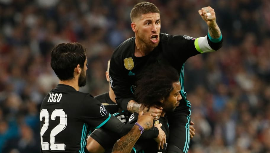 Real Madrid's Brazilian defender Marcelo(C) celebrates scoring with his team-mates Real Madrid's Spanish midfielder Isco (L) and Real Madrid's Spanish defender Sergio Ramos during the UEFA Champions League semi-final first-leg football match FC Bayern Munich v Real Madrid CF in Munich, southern Germany on April 25, 2018. (Photo by Odd ANDERSEN / AFP)        (Photo credit should read ODD ANDERSEN/AFP/Getty Images)