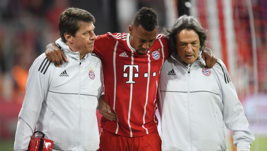 Bayern Munich's German defender Jerome Boateng (C) walks off the pitch after getting injured during the UEFA Champions League semi-final first-leg football match FC Bayern Munich v Real Madrid CF in Munich in southern Germany on April 25, 2018. (Photo by Christof STACHE / AFP)        (Photo credit should read CHRISTOF STACHE/AFP/Getty Images)