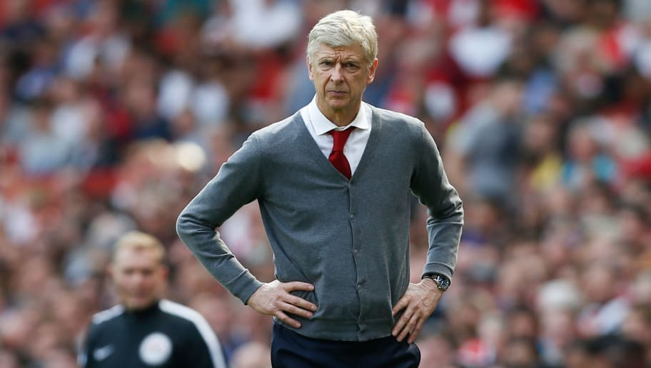 Arsenal's French manager Arsene Wenger watches on from the touch line during the English Premier League football match between Arsenal and West Ham United at the Emirates Stadium in London on April 22, 2018. (Photo by Ian KINGTON / AFP) / RESTRICTED TO EDITORIAL USE. No use with unauthorized audio, video, data, fixture lists, club/league logos or 'live' services. Online in-match use limited to 75 images, no video emulation. No use in betting, games or single club/league/player publications. /         (Photo credit should read IAN KINGTON/AFP/Getty Images)