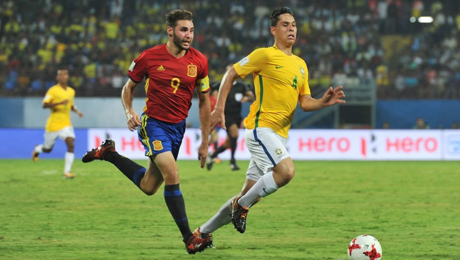 Abel Ruiz (L) of Spain and Lucas Halter of Brazil compete for the ball during their group stage football match of the FIFA U-17 World Cup at the Jawaharlal Nehru International Stadium in Kochi on October 7, 2017. The FIFA U-17 Football World Cup is taking place in India from October 6 to 28. / AFP PHOTO / Manjunath KIRAN        (Photo credit should read MANJUNATH KIRAN/AFP/Getty Images)
