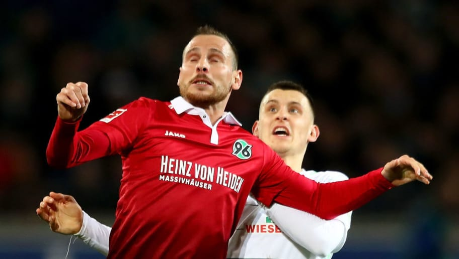 HANOVER, GERMANY - APRIL 06: Marvin Bakalorz (front) of Hannover and Maximilian Eggestein of Bremen battle for the ball during the Bundesliga match between Hannover 96 and SV Werder Bremen at HDI-Arena on April 6, 2018 in Hanover, Germany.  (Photo by Martin Rose/Bongarts/Getty Images)
