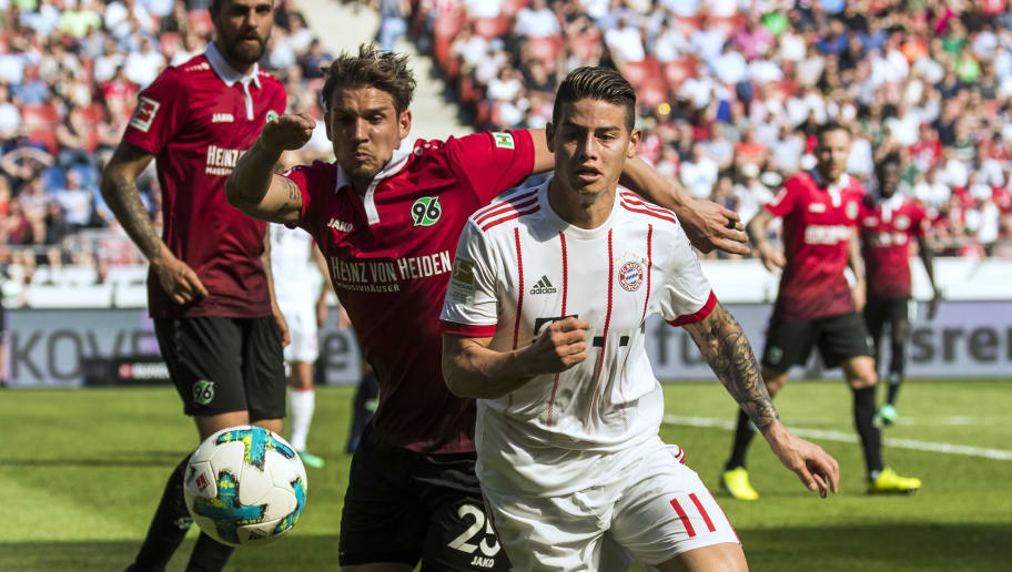 Bayern Munich's Colombian midfielder James Rodriguez (R) and Hanover's German defender Oliver Sorg vie for the ball during the German first division Bundesliga football match between Hannover 96 vs Bayern Munich in Hanover, central Germany, on April 21, 2018. (Photo by Odd ANDERSEN / AFP) / RESTRICTIONS: DURING MATCH TIME: DFL RULES TO LIMIT THE ONLINE USAGE TO 15 PICTURES PER MATCH AND FORBID IMAGE SEQUENCES TO SIMULATE VIDEO. == RESTRICTED TO EDITORIAL USE == FOR FURTHER QUERIES PLEASE CONTACT DFL DIRECTLY AT + 49 69 650050        (Photo credit should read ODD ANDERSEN/AFP/Getty Images)
