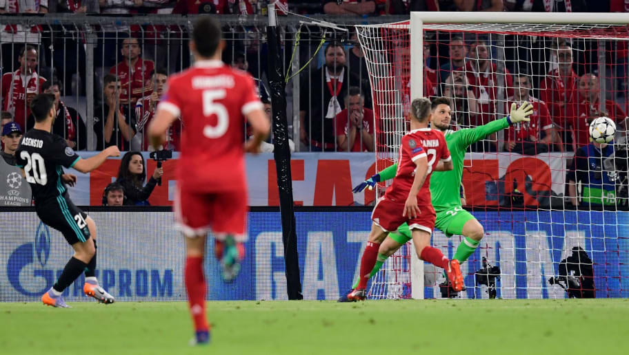Real Madrid's Spanish midfielder Marco Asensio (L) scores against Bayern Munich's German goalkeeper Sven Ulreich during the UEFA Champions League semi-final first-leg football match FC Bayern Munich v Real Madrid CF in Munich, southern Germany on April 25, 2018. (Photo by JAVIER SORIANO / AFP)        (Photo credit should read JAVIER SORIANO/AFP/Getty Images)