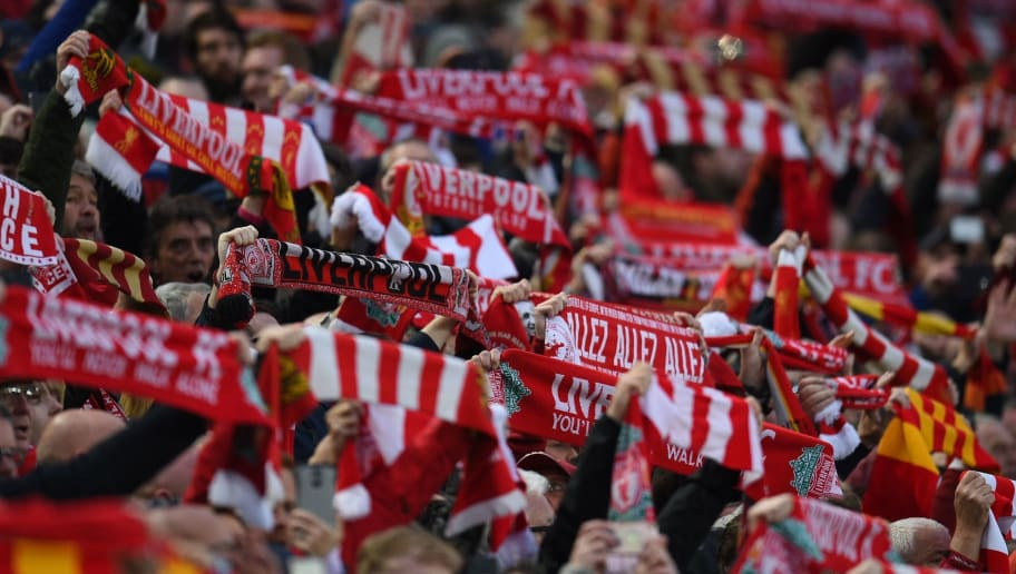TOPSHOT - Liverpool fans cheer on their team as they lead 3-0 during the UEFA Champions League first leg semi-final football match between Liverpool and Roma at Anfield stadium in Liverpool, north west England on April 24, 2018. (Photo by Oli SCARFF / AFP)        (Photo credit should read OLI SCARFF/AFP/Getty Images)
