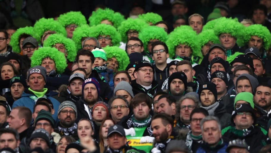 STUTTGART, GERMANY - FEBRUARY 11: Fans of Moenchengladbach react during the Bundesliga match between VfB Stuttgart and Borussia Moenchengladbach at Mercedes-Benz Arena on February 11, 2018 in Stuttgart, Germany.  (Photo by Alex Grimm/Bongarts/Getty Images)