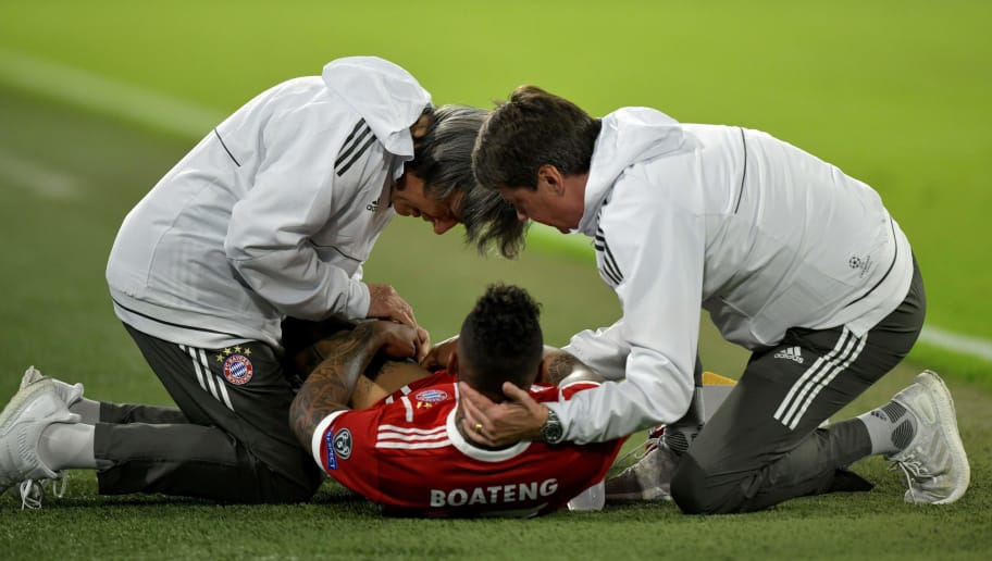 Bayern Munich's German defender Jerome Boateng receives medical care by team doctor Hans-Wilhelm Mueller-Wohlfahrt (L) after being injured during the UEFA Champions League semi-final first-leg football match FC Bayern Munich v Real Madrid CF in Munich, southern Germany on April 25, 2018. (Photo by GUENTER SCHIFFMANN / AFP)        (Photo credit should read GUENTER SCHIFFMANN/AFP/Getty Images)