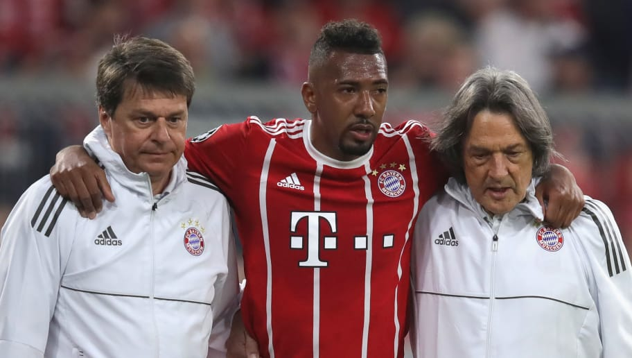 MUNICH, GERMANY - APRIL 25:  Jerome Boateng of Muenchen reacts as he leaves the field of play after getting  injured during the UEFA Champions League Semi Final First Leg match between Bayern Muenchen and Real Madrid at the Allianz Arena on April 25, 2018 in Munich, Germany.  (Photo by Alexander Hassenstein/Bongarts/Getty Images)