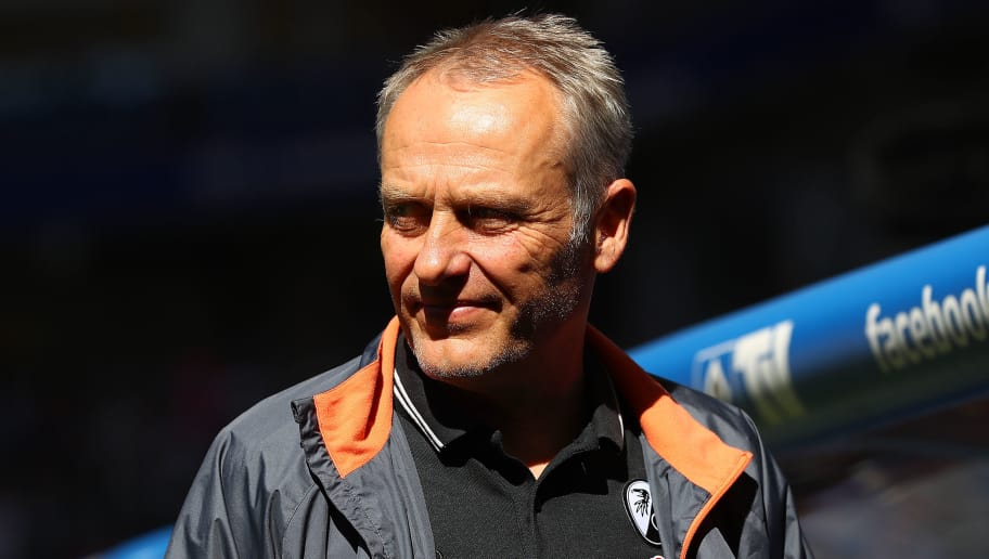 HAMBURG, GERMANY - APRIL 21: Coach Christian Streich of Freiburg looks on before the Bundesliga match between Hamburger SV and Sport-Club Freiburg at Volksparkstadion on April 21, 2018 in Hamburg, Germany. (Photo by Martin Rose/Bongarts/Getty Images)