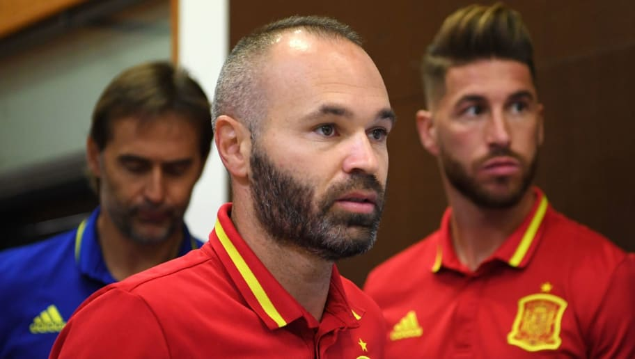 Spain's midfielder Andres Iniesta (C) arrives followed by Spain's defender Sergio Ramos (R) and Spain's coach Julen Lopetegui to give a press conference at the Royal Spanish Football Federation's 'Ciudad del Futbol' in Madrid on September 1, 2017 on the eve of their World Cup 2018 qualifier football match against Italy. / AFP PHOTO / GABRIEL BOUYS        (Photo credit should read GABRIEL BOUYS/AFP/Getty Images)
