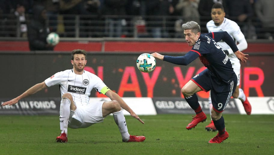 Frankfurt's Argentinian defender David Abraham (L) and Bayern Munich's Polish forward Robert Lewandowski vie for the ball during the German first division Bundesliga football match of Eintracht Frankfurt vs FC Bayern Munich on December 9, 2017 in Frankfurt am Main, western Germany. / AFP PHOTO / Daniel ROLAND / RESTRICTIONS: DURING MATCH TIME: DFL RULES TO LIMIT THE ONLINE USAGE TO 15 PICTURES PER MATCH AND FORBID IMAGE SEQUENCES TO SIMULATE VIDEO. == RESTRICTED TO EDITORIAL USE == FOR FURTHER QUERIES PLEASE CONTACT DFL DIRECTLY AT + 49 69 650050         (Photo credit should read DANIEL ROLAND/AFP/Getty Images)