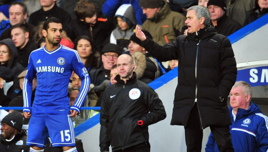 Chelsea's Portuguese manager Jose Mourinho (R) gives instructions to Chelsea's Egyptian midfielder Mohamed Salah (L) during the English Premier League football match between Chelsea and Newcastle United at Stamford Bridge in west London on February 8, 2014. Chelsea won the game 3-0. AFP PHOTO / GLYN KIRK  RESTRICTED TO EDITORIAL USE. No use with unauthorized audio, video, data, fixture lists, club/league logos or live services. Online in-match use limited to 45 images, no video emulation. No use in betting, games or single club/league/player publications.        (Photo credit should read GLYN KIRK/AFP/Getty Images)