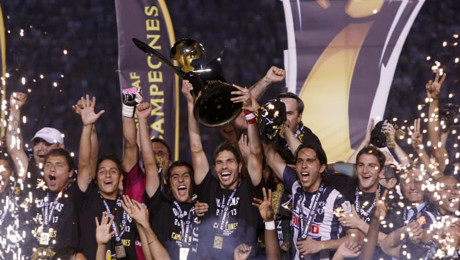 Players of Monterrey celebrate with the trophy their victory in their CONCACAF Champions League final match at Tecnologico stadium in Monterrey, Nuevo Leon state on May 1, 2013. AFP PHOTO/Julio Cesar Aguilar        (Photo credit should read Julio Cesar Aguilar/AFP/Getty Images)