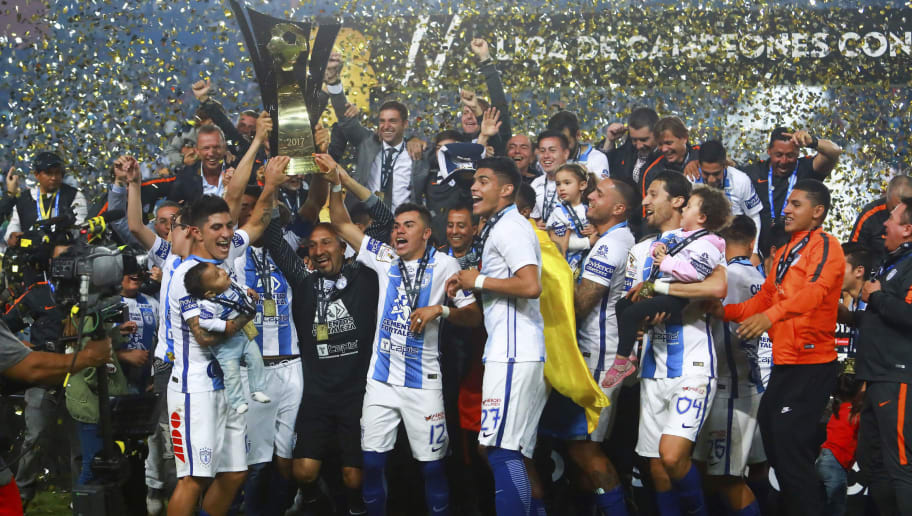 MEXICO CITY, MEXICO - APRIL 26: Oscar Perez and Emmanuel Garcia of Pachuca lift the trophy to celebrate with teammates after winning the Final second leg match between Pachuca and Tigres UANL as part of the CONCACAF Champions League 2016/17 at Hidalgo Stadium on April 26, 2017 in Monterrey, Mexico. (Photo by Hector Vivas/LatinContent/Getty Images)