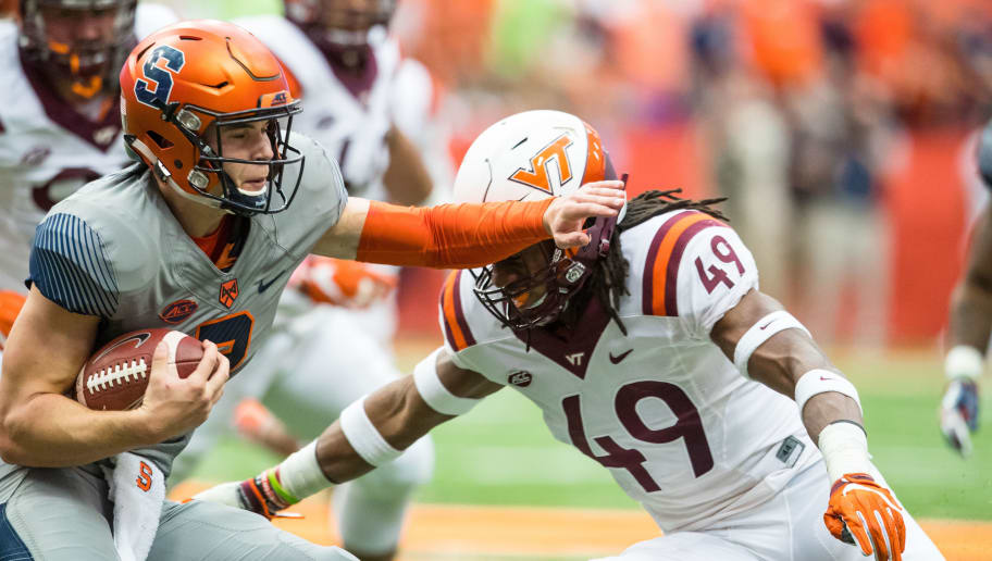 SYRACUSE, NY - OCTOBER 15: Eric Dungey #2 of the Syracuse Orange tries to stop a tackle by Tremaine Edmunds #49 of the Virginia Tech Hokies during the first quarter on October 15, 2016 at The Carrier Dome in Syracuse, New York. (Photo by Brett Carlsen/Getty Images)