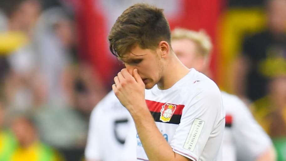 Leverkusen's Greek defender Panagiotis Retsos reacts after the German first division Bundesliga football match Borussia Dortmund vs Bayer Leverkusen, in Dortmund, western Germany, on April 21, 2018. (Photo by Patrik STOLLARZ / AFP) / RESTRICTIONS: DURING MATCH TIME: DFL RULES TO LIMIT THE ONLINE USAGE TO 15 PICTURES PER MATCH AND FORBID IMAGE SEQUENCES TO SIMULATE VIDEO. == RESTRICTED TO EDITORIAL USE == FOR FURTHER QUERIES PLEASE CONTACT DFL DIRECTLY AT + 49 69 650050        (Photo credit should read PATRIK STOLLARZ/AFP/Getty Images)