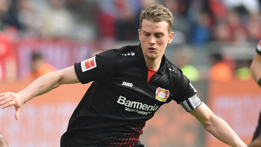 Leverkusen's German midfielder Lars Bender vies for the ball during the German first division Bundesliga football match Bayer 04 Leverkusen vs Eintracht Frankfurt, in Leverkusen, western Germany, on April 14, 2018. / AFP PHOTO / Patrik STOLLARZ / RESTRICTIONS: DURING MATCH TIME: DFL RULES TO LIMIT THE ONLINE USAGE TO 15 PICTURES PER MATCH AND FORBID IMAGE SEQUENCES TO SIMULATE VIDEO. == RESTRICTED TO EDITORIAL USE == FOR FURTHER QUERIES PLEASE CONTACT DFL DIRECTLY AT + 49 69 650050         (Photo credit should read PATRIK STOLLARZ/AFP/Getty Images)
