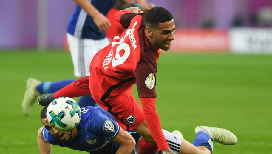 Schalke's Algerian midfielder Nabil Bentaleb and Frankfurt's Spanish midfielder Omar Mascarell vie for the ball during the German Cup DFB Pokal semi-final football match Schalke 04 vs Eintracht Frankfurt in Gelsenkirchen, western Germany, on April 18, 2018. / AFP PHOTO / Patrik STOLLARZ / RESTRICTIONS: ACCORDING TO DFB RULES IMAGE SEQUENCES TO SIMULATE VIDEO IS NOT ALLOWED DURING MATCH TIME. MOBILE (MMS) USE IS NOT ALLOWED DURING AND FOR FURTHER TWO HOURS AFTER THE MATCH. == RESTRICTED TO EDITORIAL USE == FOR MORE INFORMATION CONTACT DFB DIRECTLY AT +49 69 67880   /         (Photo credit should read PATRIK STOLLARZ/AFP/Getty Images)