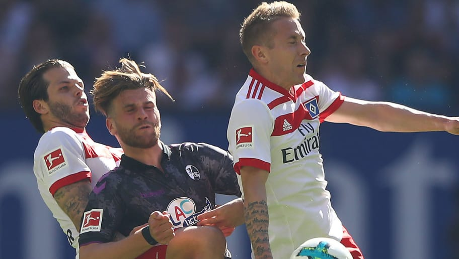 HAMBURG, GERMANY - APRIL 21: (L-R:) Dennis Diekmeier of Hamburg, Nicolas Hoefler of Freiburg and Lewis Holtby of Hamburg fight for the ball during the Bundesliga match between Hamburger SV and Sport-Club Freiburg at Volksparkstadion on April 21, 2018 in Hamburg, Germany. (Photo by Martin Rose/Bongarts/Getty Images)
