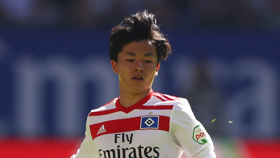 HAMBURG, GERMANY - APRIL 21: Tatsuya Ito of Hamburg runs with the ball during the Bundesliga match between Hamburger SV and Sport-Club Freiburg at Volksparkstadion on April 21, 2018 in Hamburg, Germany. (Photo by Martin Rose/Bongarts/Getty Images)