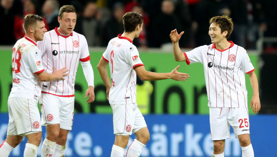 DUESSELDORF, GERMANY - JANUARY 24: (L-R) The team of Duesseldorf with Rouwen Hennings, Robin Bormuth, Florian Neuhaus and Genki Haraguchi celebrate after the Second Bundesliga match between Fortuna Duesseldorf and FC Erzgebirge Aue at Esprit-Arena on January 24, 2018 in Duesseldorf, Germany. The match between Duesseldorf and Aue ended 2-1. (Photo by Christof Koepsel/Bongarts/Getty Images)
