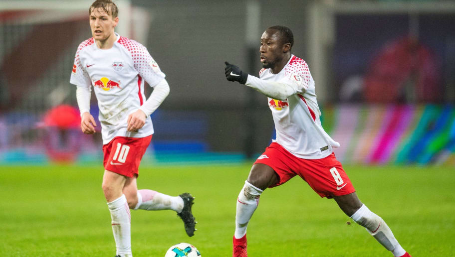 Leipzig's Guinean midfielder Naby Deco Keita (R) vies with Swedish forward Emil Forsberg during the German first division Bundesliga football match between RB Leipzig and Werder Bremen in Leipzig, eastern Germany, on November 25, 2017.  / AFP PHOTO / ROBERT MICHAEL / RESTRICTIONS: DURING MATCH TIME: DFL RULES TO LIMIT THE ONLINE USAGE TO 15 PICTURES PER MATCH AND FORBID IMAGE SEQUENCES TO SIMULATE VIDEO. == RESTRICTED TO EDITORIAL USE == FOR FURTHER QUERIES PLEASE CONTACT DFL DIRECTLY AT + 49 69 650050         (Photo credit should read ROBERT MICHAEL/AFP/Getty Images)