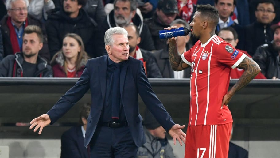 Bayern Munich's German head coach Jupp Heynckes(L) taks to Bayern Munich's German defender Jerome Boateng during the UEFA Champions League quarter-final second leg football match between FC Bayern Munich and Sevilla FC on April 11, 2018 in Munich, southern Germany. / AFP PHOTO / John MACDOUGALL        (Photo credit should read JOHN MACDOUGALL/AFP/Getty Images)